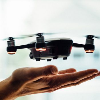 Drone landing on hand. Online Drone Training by 3iC